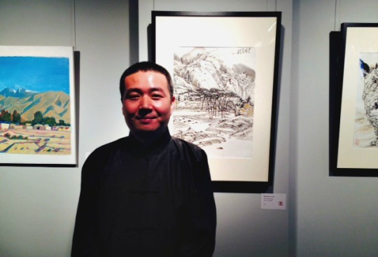 Exhibiting artist Shen Dawei with his brush and ink paintings, came all the from China for the grand opening.