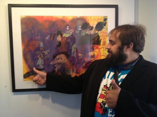 Artist Vito Bonanno next to his artwork in the Sumner McKnight Crosby Jr Gallery last fall.